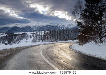 Beautiful mountain road in winter, in Transylvania, Romania