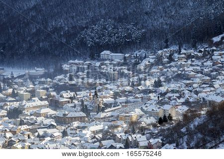 Winter view of Brasov medieval city, at sunrise, from above