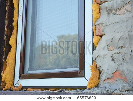 Install Window insulation with foam. If you replace your windows you will want to insulate around the opening with spray foam insulation for energy saving. A mosquito windows net offers protection.
