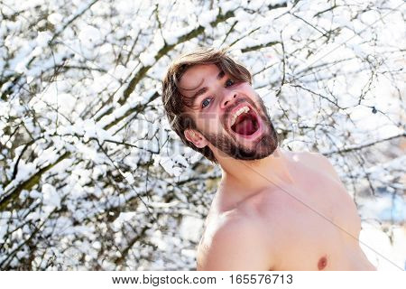 Happy Muscular Man In Winter Forest