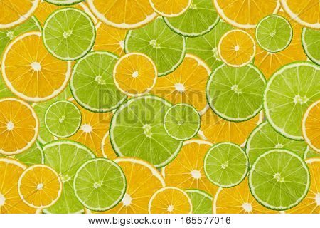 Slices of fresh lime and lemon texture background seamless pattern