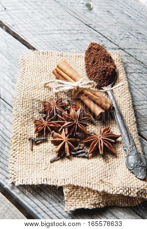 Fragrant Spices, Coffee, Cinnamon, Cloves And Anise On Sackcloth