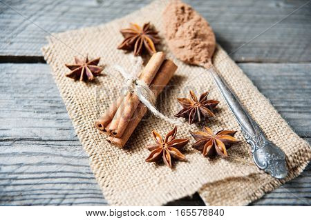 Cinnamon, Cocoa, Anise On Wooden Table