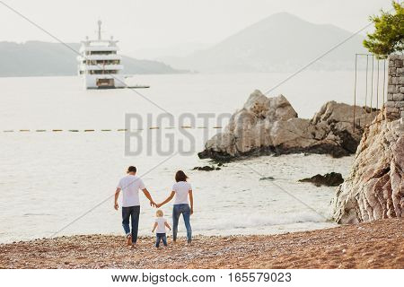 Family Relax On Beach