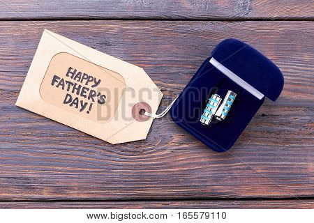 Cufflinks and Father's Day tag. Label near box with cufflinks. Elegant present for daddy.