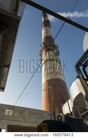 tall chimney and fragments of dust collectors and exhaust duct