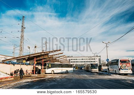 Riga, Latvia - December 1, 2016: Buses parked at the Riga International Coach Terminal, bus station. People waiting for bus departure.