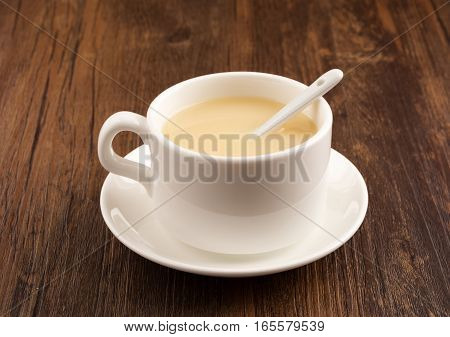 cup of tea with milk on the table