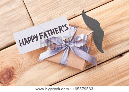 Father's Day gift and mustache. Greeting card and present box. Creative greeting for daddy.