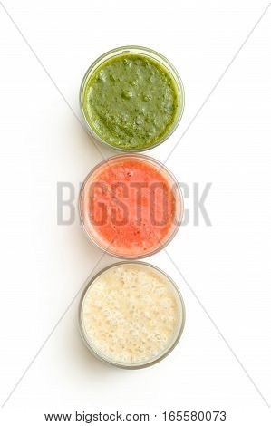 Glasses With Herbs, Strawberry And Banana Smoothie Isolated On White Background