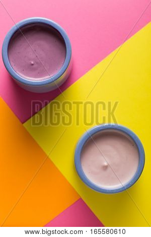 Yogurts Assortment  In Ceramic Bowls On Colorful Background. Natural And Fruit Healthy, Diet, Gourme