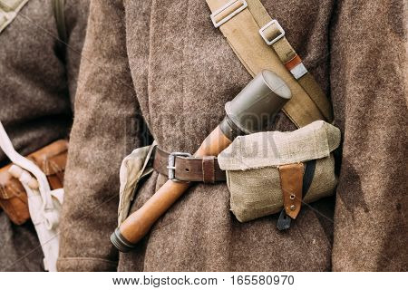 Close up of military ammunition of a Red Army Russian Soviet Infantry Soldier at World War II. Soldier's warm cotton wool-padded jacket - Telogreika or vatnik, pouch, rifle.