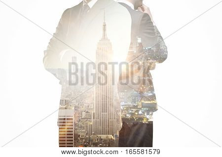 Thoughtful businesspeople on New York city background. Research concept. Double exposure