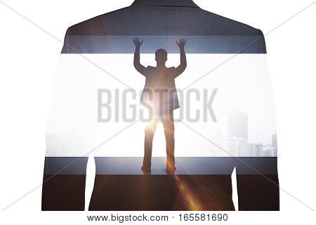 Back view of struggling man on city background with sunlight. Pressure concept. Double exposure