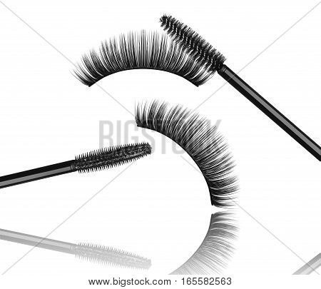 Black mascara brush with false eyelashes close-up isolated on white