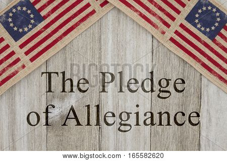 America patriotic message USA patriotic old flag on a weathered wood background with text The Pledge of Allegiance