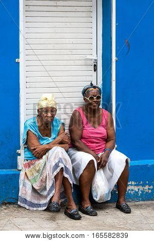 Havana, Cuba 01.16.2008 Two Cuban women sitting on the stoops of the house in Old Havana