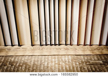 top view of a book on a wooden shelf