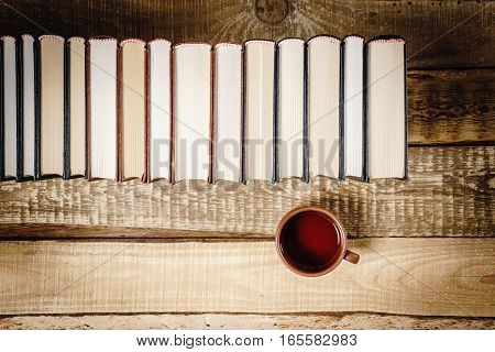 top view of a book and a cup of hot tea