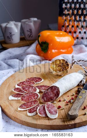 Salami On The Kitchen Board, Cut Into Slices