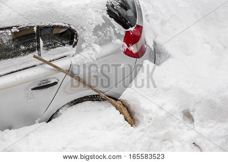 Closeup of stuck car in heavy snow during winter