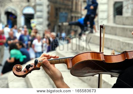Violinist street on the steps of a church