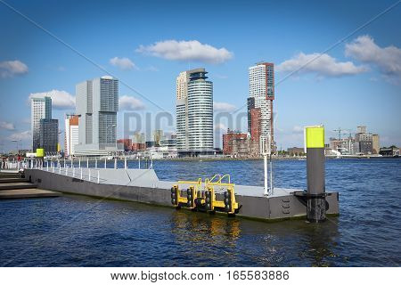 Pier On The Nieuwe Maas River In Rotterdam, The Netherlands