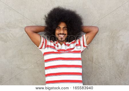 Confident Man Standing With Hands In Hair Relaxed