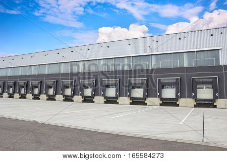 Loading Dock Cargo Doors At Big Warehouse, Building Exterior