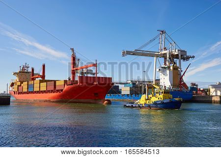 Industrial ship (Tanker) at sea towed by tug Porto Portugal