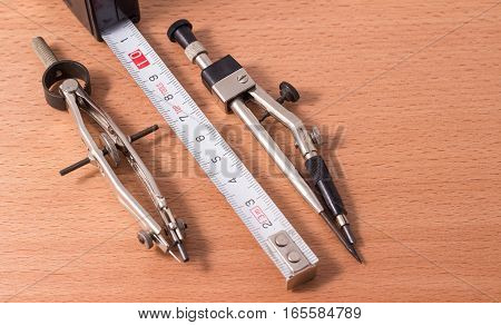 the compasses are the drawing tool he is used by engineers school students students he serves for a tracing of rotundities and for measurement of distance
