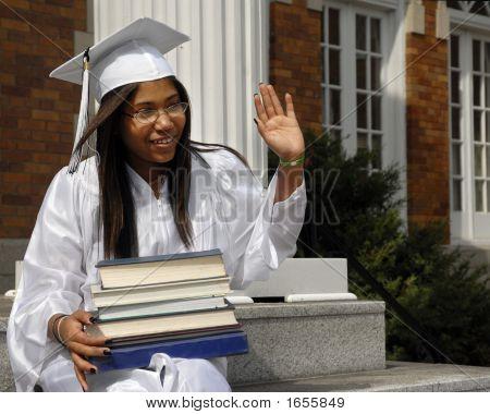 Graduate Waving To Friends