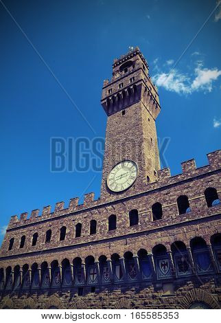 Florence Old Palace And Clock Tower With Blue Sky In Signoria Sq
