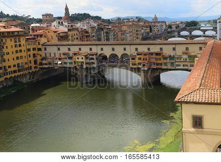 ancient bridge called Ponte Vecchio and Vasari Corridor in Florence Italy poster