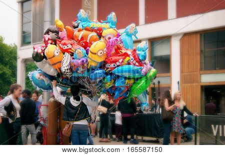 Bristol UK - July 16 2016: a woman selling balloons in The 45th Harbour Festival in Bristol UK
