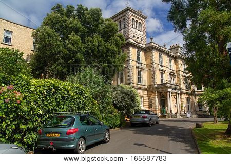 EXETER DEVON UK - July 11 2016: Old campus of the University of Exeter. Reed Hall. Many of green trees. Summer. Day.