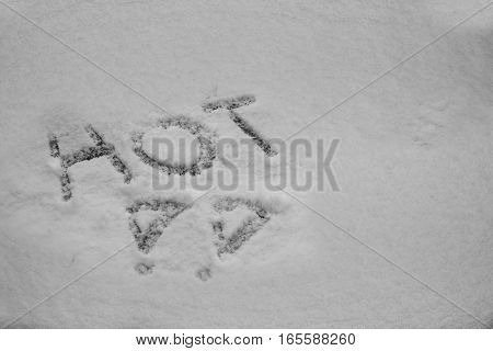 close up on Word hot written in snow
