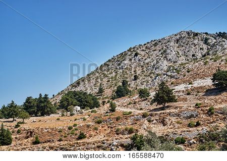 Orthodox chapel on a rocky on the island of Kos in Greece