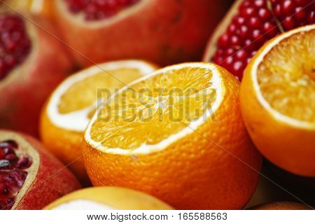 Vegetarian food cut orange and pomegranate .