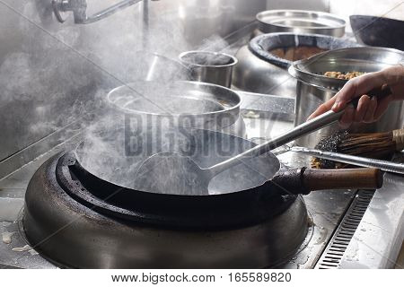 Close Up Of Working Chef Preparing Chinese Food