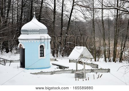 Orthodox chapel in the winter woods for your design
