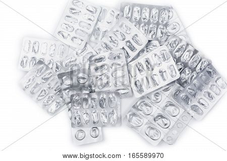 pile of empty packing from tablets on white background. Treatment tablets
