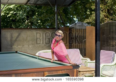 the beautiful woman rests on a billiard table a subject beautiful women rest a game entertainments vacation