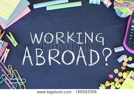 Work abroad employment concept text working abroad on blackboard