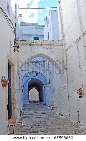 Street view in the beautiful white city of Ostuni Italy Europe
