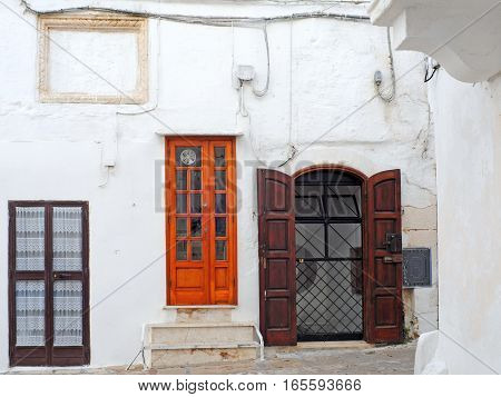 Street view with antique doors and window in Ostuni Italy Europe