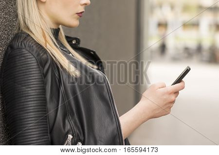Attractive young business woman talking on mobile phone