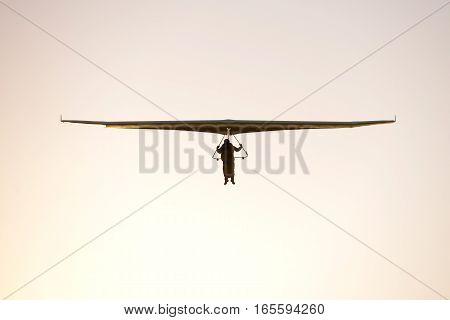 Hang Glider Flying Towards The Camera At Sunset