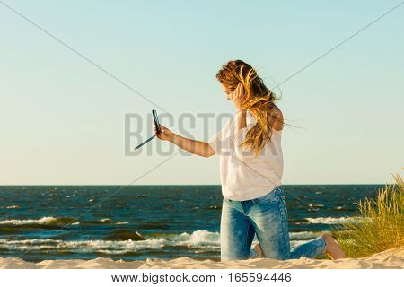 Happy Woman With Phone Taking Selfie Photo.