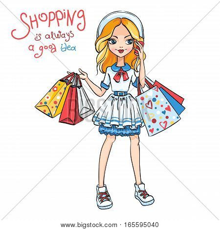 Cute fashion girl in dress and hat with shopping